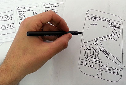 James's hand sketching a smartphone map interface